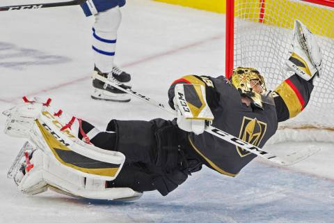 Vegas Golden Knights goaltender Marc-Andre Fleury makes a diving save in the third period durin ...