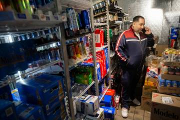 Operations manager Kevork Nersessian talks to a supplier in his depleted cooler at Liquor Empor ...