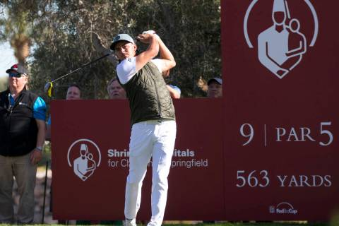 Rickie Fowler watches his drive from the ninth tee during the first round of the Shriners Hospi ...