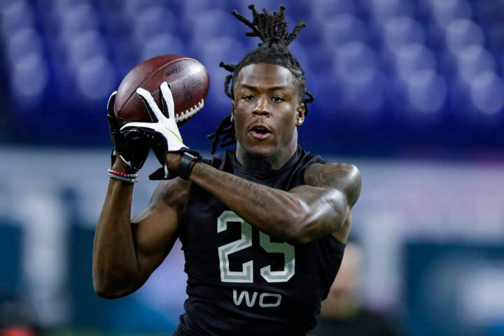 Alabama wide receiver Jerry Jeudy runs a drill at the NFL football scouting combine in Indianap ...