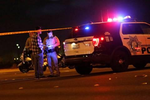 Police work at the scene of a fatal crash near Durango Drive and Twain Avenue in Las Vegas, Sun ...