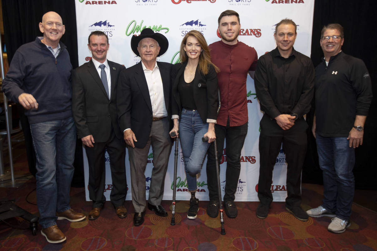 The Southern Nevada Sports Hall of Fame class of 2020 and SNSHF administration poses for a port ...