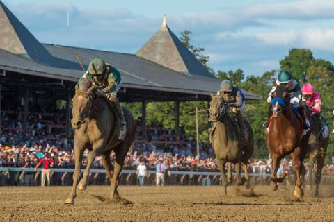 FILE- In this Aug. 24, 2019, file photo, Code of Honor, left, with jockey John Velazquez, leads ...