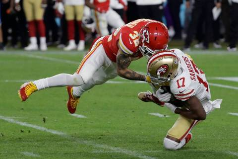 Kansas City Chiefs' Tyrann Mathieu (32) tackles San Francisco 49ers' Emmanuel Sanders (17) duri ...