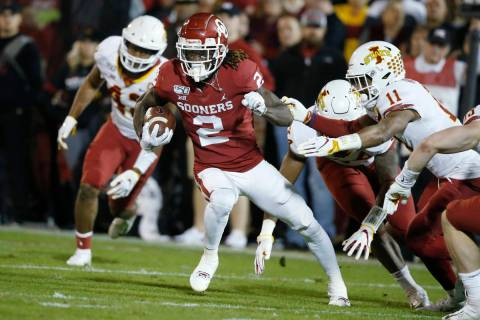 FILE - In this Nov. 9, 2019, file photo, Oklahoma wide receiver CeeDee Lamb (2) carries during ...