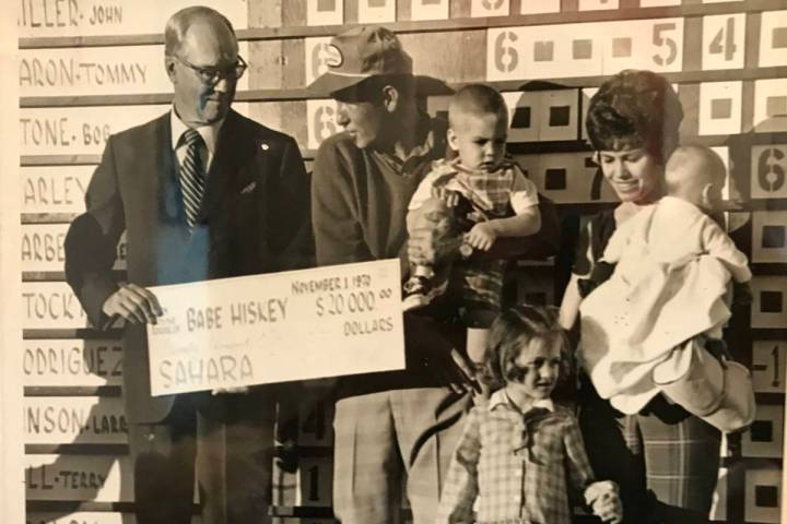 Del Webb presents Babe Hiskey with $20,000 for winning the 1970 Sahara Invitational. With Hiske ...