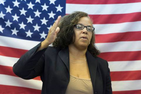 Assemblywoman Dina Neal speaks during the opening of Democratic presidential candidate Hillary ...