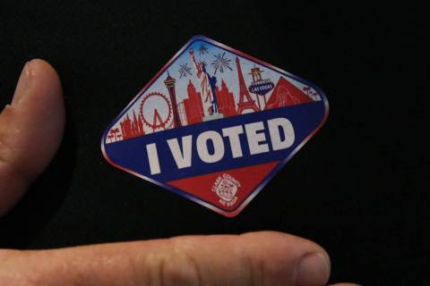 """Kirk Rossmann shows off his """"I Voted"""" sticker after casting his ballots at a polling station in ..."""