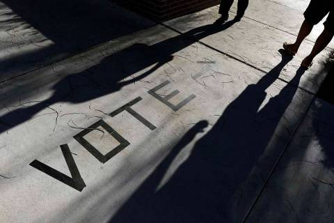 Voters head to the polls at the Enterprise Library in Las Vegas in this 2018 file photo. (AP P ...