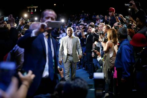 Boxer Floyd Mayweather Jr. arrives for a news conference, Wednesday, March 11, 2015, in Los Ang ...