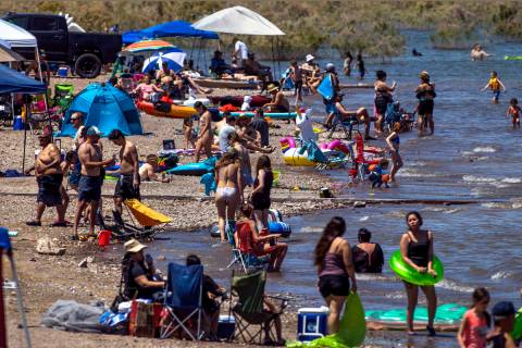 Visitors practice little social distancing at Boulder Beach in the Lake Mead National Recreatio ...