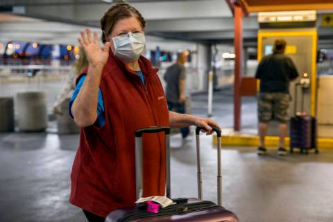 Susan Yowell waves goodbye as husband Jack pays for parking after arriving at McCarran Internat ...