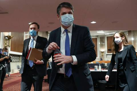 Judge Justin Walker leaves after testifying in a Senate Judiciary Committee hearing on Walker's ...