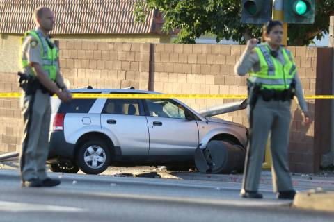 Las Vegas police investigate after a pedestrian was struck by a Saturn Vue SUV near South La Ca ...
