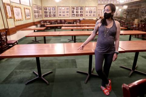 Penny Chutima, whose family owns Lotus of Siam, discusses social distancing table arrangement a ...