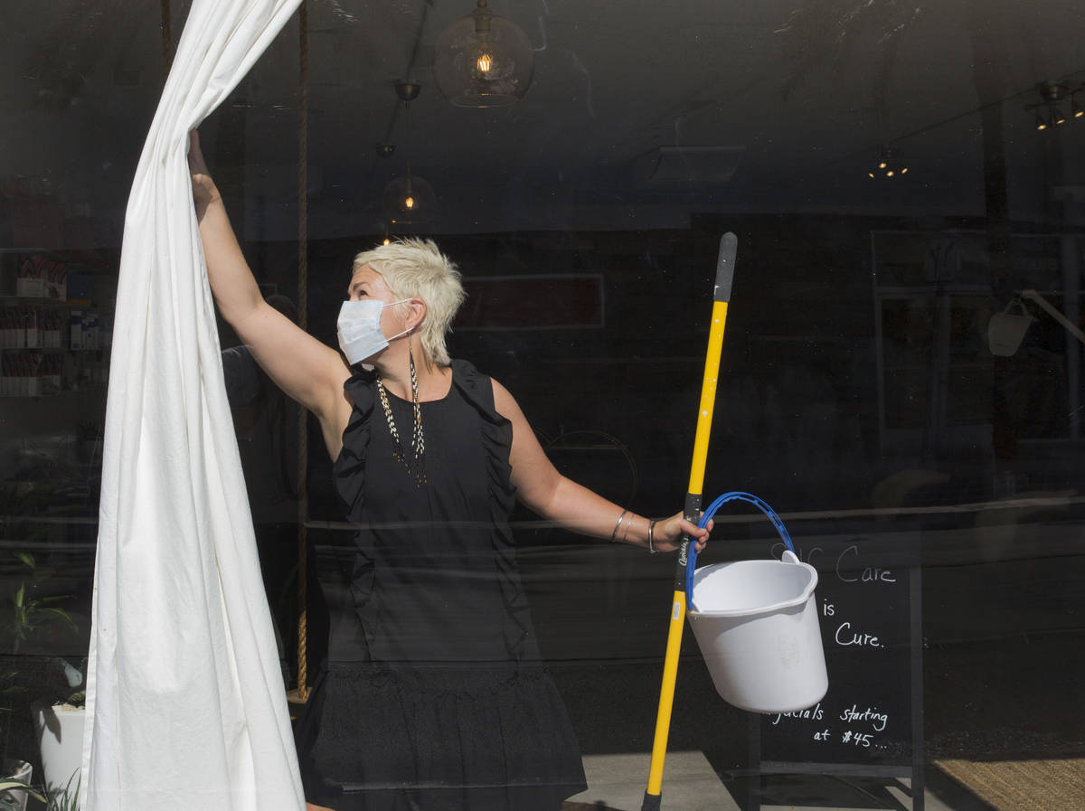 Megan Linney opens the curtain of her downtown Las Vegas skin care salon, The Layer Lounge, on ...