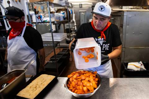 Vincent Rotolo, owner of Good Pie, gets ready to make a triple pepperoni Detroit style pizza in ...