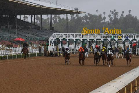 Horses run in the fourth race at Santa Anita Park in front of empty stands Saturday, March 14, ...