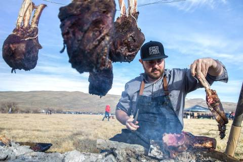 Chef Justin Kingsley Hall, with The Kitchen at Atomic, prepares cape grim tomahawk steaks durin ...