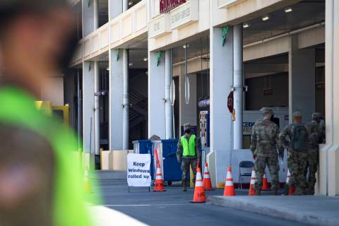 The Nevada National Guard waits for patients at the COVID-19 drive-through testing at the parki ...