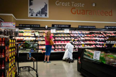 A worker stocks shelves in the meat section at Albertson's in Las Vegas on Saturday, May 2, 202 ...