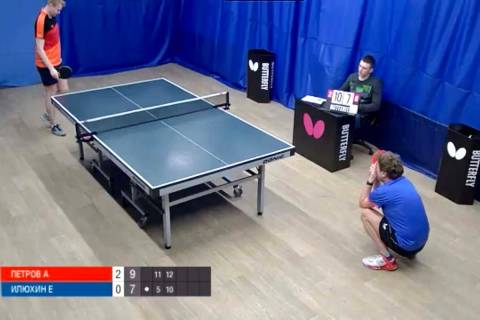 Evgeniy Ilyukhin (in blue) reacts after missing a shot against Aleksandr Petrov in a Moscow Lig ...