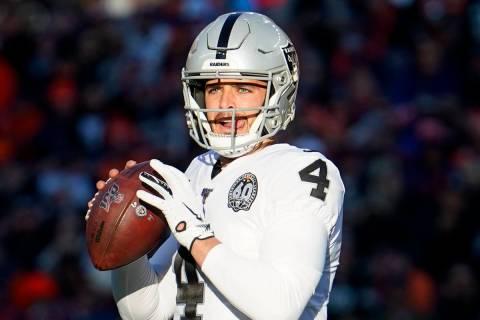 Oakland Raiders quarterback Derek Carr (4) throws a pass during the first half of an NFL footba ...