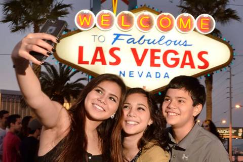 Chiara Atienza, from Quad Cities, Iowa, left, poses with her siblings, Catia, center, and Caide ...