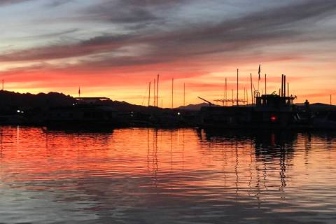 Lake Mead Marina at Sunset. Holiday visitors can expect to find busy launch ramps over the busy ...