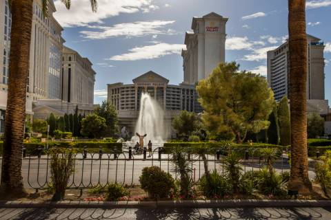 Cyclists pause to view the main Caesars Palace fountain area now back in operation on Monday, M ...