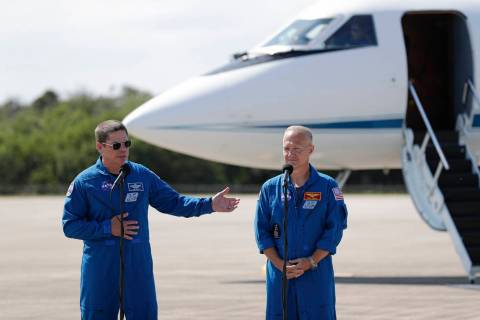 NASA astronauts Robert Behnken , left, and Doug Hurley speak during a news conference after the ...
