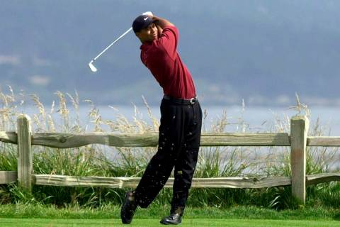 FILE - In this June 18, 2000, file photo, Tiger Woods tees off on the 18th hole on his way to w ...
