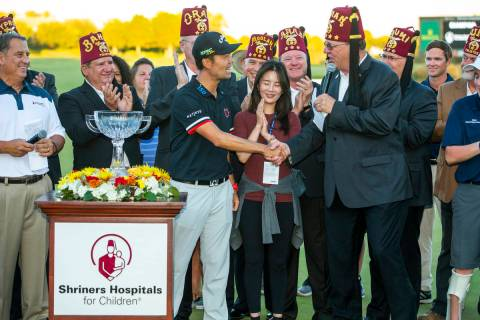 Kevin Na, center, shakes the hand of Imperial Potentate Jerry Gantt after winning the tournamen ...