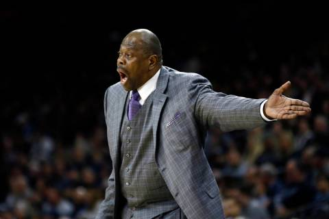 In this Saturday, Jan. 11, 2020, file photo, Georgetown head coach Patrick Ewing yells to his t ...