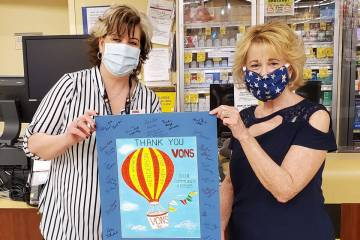 Robyn Howell (right) designed a poster for the staff at Vons at 2511 Anthem Village, Henderson ...