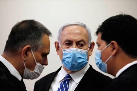 Israeli Prime Minister Benjamin Netanyahu, wearing a face mask in line with public health restr ...