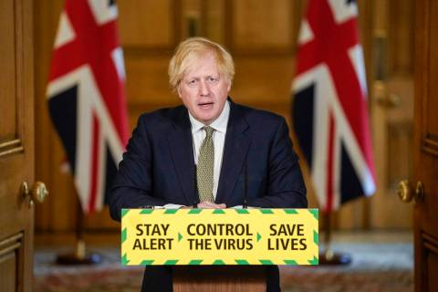In this photo issued by 10 Downing Street, Britain's Prime Minister Boris Johnson speaks during ...