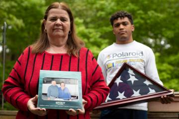 In this Friday, May 22, 2020, photo Florence Hopp, left, holds a photograph of herself and her ...