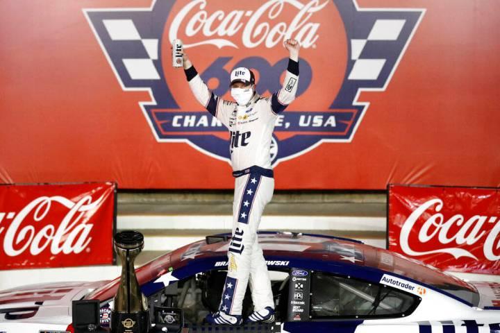 Brad Keselowski celebrates after winning the NASCAR Cup Series auto race at Charlotte Motor Spe ...