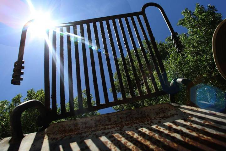 A park charcoal grill is seen against the blue sky at Floyd Lamb Park Tuesday, April 28, 2020, ...