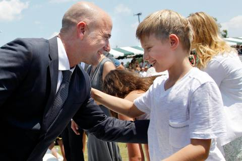 Tennis great Andre Agassi greets his son, Jaden, 9, after being inducted to the International T ...