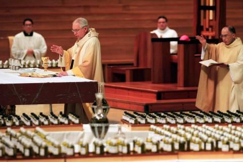 FILE - In this April 6, 2020 file photo, Los Angeles Archbishop Jose H. Gomez, front, celebrate ...