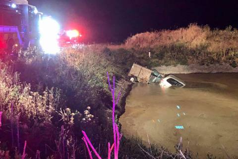 A vehicle is partially submerged in a manure pond Monday, May 25, 2020, in South Sacramento, Ca ...