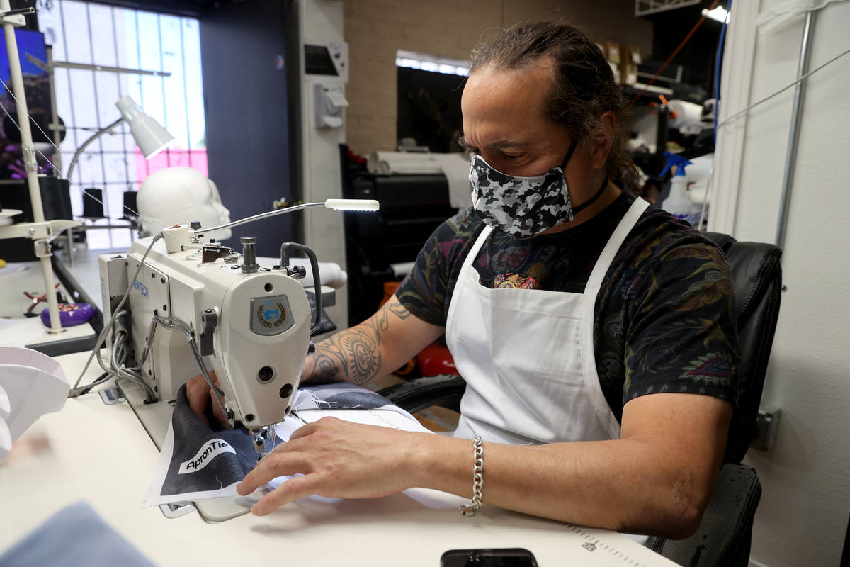 Former chef Jean Paul Labadie, creator of ApronTie, sews his product for chefs at his factory i ...