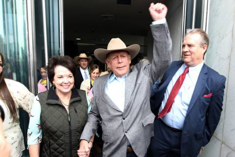 Cliven Bundy walks out of Lloyd George U.S. Courthouse in Las Vegas a free man with his wife, C ...