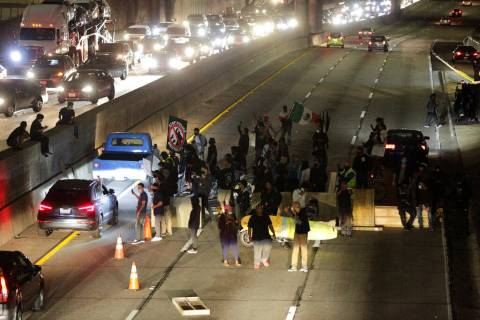 Demonstrators shut down the northbound CA-110 freeway to protest the killing of George Floyd, i ...