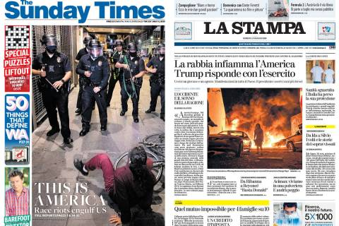 The Australian Sunday Times, left, and La Stampa of Torino, Italy, use their front pages to cov ...