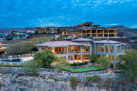 The estate at 1508 View Field Court is perched on a 1-acre hillside in MacDonald Highlands. It ...