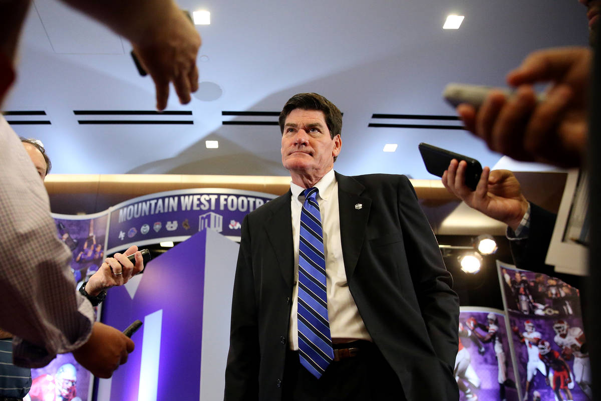 Commissioner Craig Thompson, center, is interviewed during the Mountain West Conference footbal ...