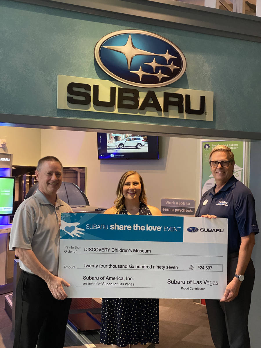 Caitlin Shea, director of development of the Discovery Children's Museum, receives a check fo ...